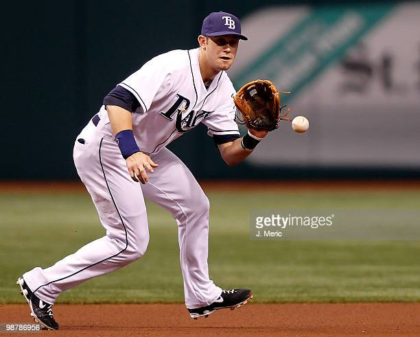 Infielder Evan Longoria of the Tampa Bay Rays fields a ground ball against the Kansas City Royals during the game at Tropicana Field on May 1 2010 in...