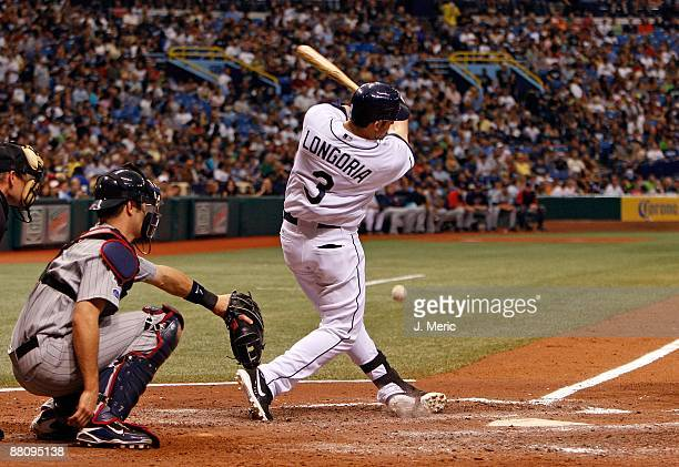 Infielder Evan Longoria of the Tampa Bay Rays fouls off a pitch against the Minnesota Twins during the game at Tropicana Field on May 30 2009 in St...