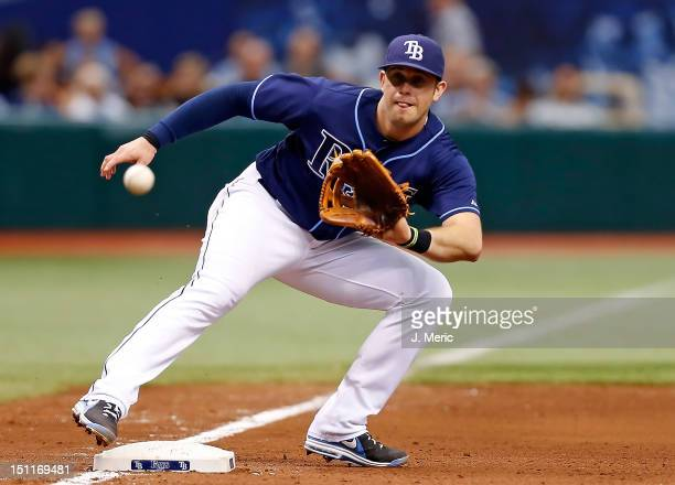 Infielder Evan Longoria of the Tampa Bay Rays takes the throw at third against the Oakland Athletics during the game at Tropicana Field on August 25...