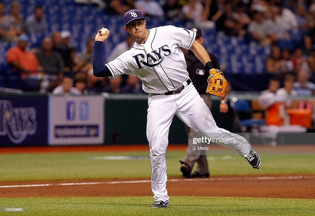 Infielder Evan Longoria #3 of the Tampa Bay Rays throws over to first for an out against the Toronto Blue Jays during the game at Tropicana Field on August 2, 2011 in St. Petersburg, Florida.