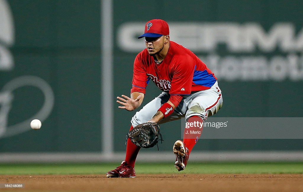 Infielder Freddy Galvis #13 of the Philadelphia Phillies fields a ground ball against the Boston Red Sox during a Grapefruit League Spring Training Game at JetBlue Park on March 21, 2013 in Fort Myers, Florida.