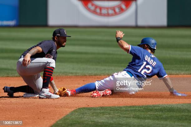Infielder Gabriel Arias of the Cleveland Indians tags out Rougned Odor of the Texas Rangers at second base during the second inning of the MLB spring...