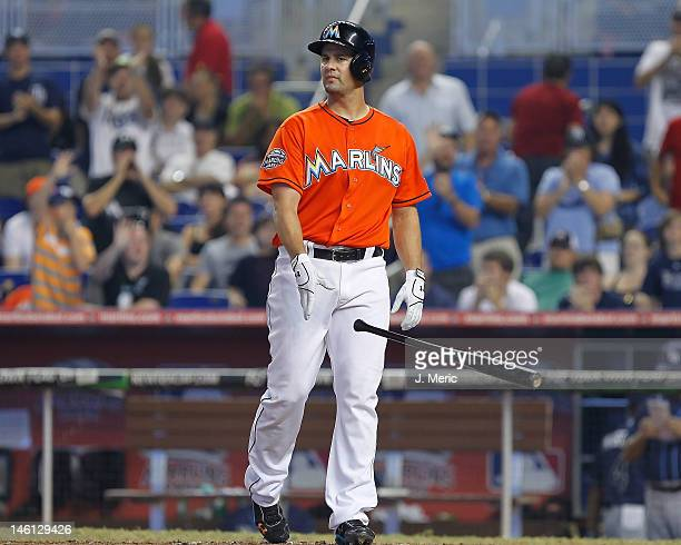Infielder Gaby Sanchez of the Miami Marlins throws his bat after striking out against the Tampa Bay Rays during the game at Marlins Park on June 10...