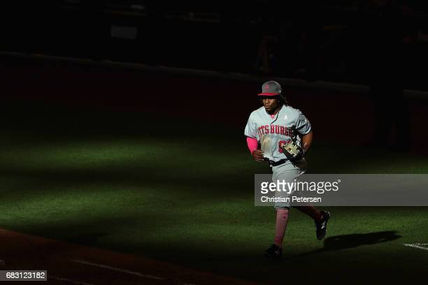 Infielder Gift Ngoepe of the Pittsburgh Pirates runs onto the field during the 10th inning of the MLB game against the Arizona Diamondbacks at Chase...