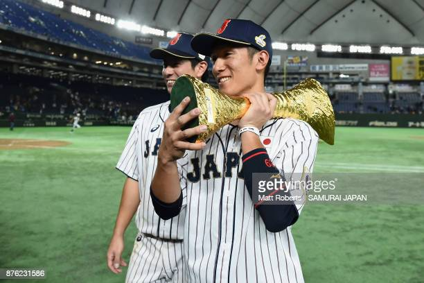Infielder Go Matsumoto and Infielder Ryoma Nishikawa of Japan pose with the trophy after the Eneos Asia Professional Baseball Championship 2017 final...