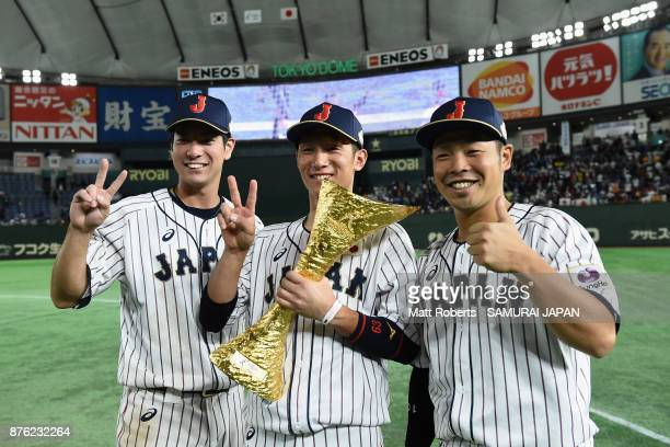 Infielder Go Matsumoto Infielder Ryoma Nishikawa and Catcher Kensuke Kondo of Japan pose with the trophy after the Eneos Asia Professional Baseball...