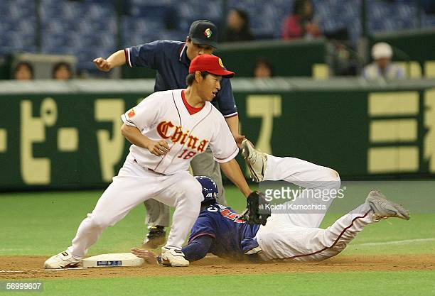 Infielder Guogang Yang of China fails to tag the steal of Infielder ChingLung Hu of Chinese Taipei at the third base during the first round of the...