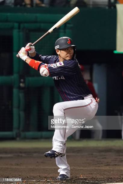 Infielder Hayato Sakamoto of Japan at bat in the top of 3rd inning during the game two between Samurai Japan and Canada at the Okinawa Cellular...