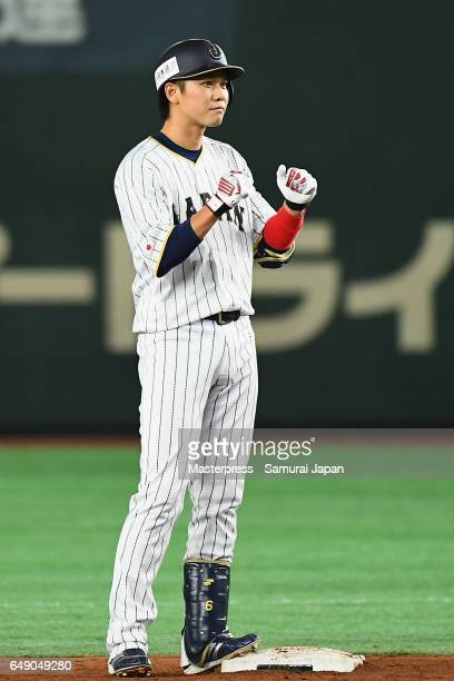 Infielder Hayato Sakamoto of Japan celebrates after hitting a RBI double to make it 13 in the bottom of the fifth inning during the World Baseball...