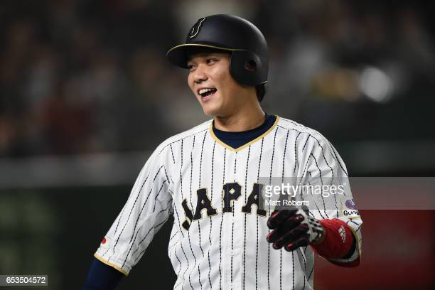 Infielder Hayato Sakamoto of Japan celebrates after scoring a run by a RBI double of Infielder Nobuhiro Matsuda to make it 02 in the bottom of the...