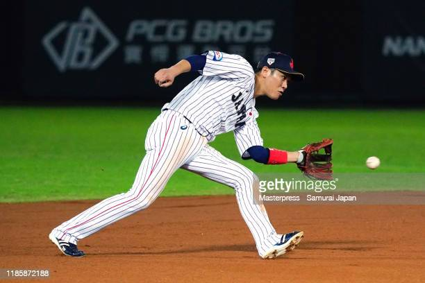 Infielder Hayato Sakamoto of Japan fields in the top of 6th inning during the WBSC Premier 12 Opening Round Group B game between Japan and Puerto...