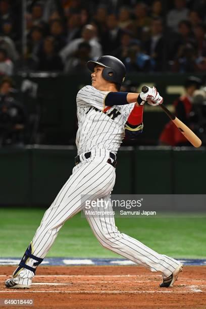 Infielder Hayato Sakamoto of Japan flies out in the bottom of the first inning during the World Baseball Classic Pool B Game One between Cuba and...