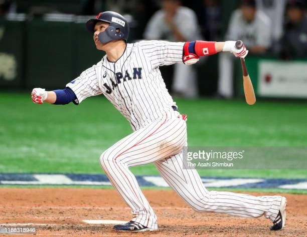 Infielder Hayato Sakamoto of Japan hits a double in the bottom of 7th inning during the WBSC Premier 12 final game between Japan and South Korea at...