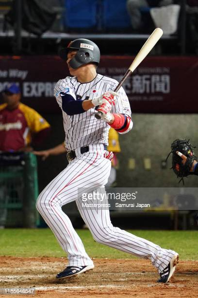 Infielder Hayato Sakamoto of Japan hits a grounder in the bottom of 5th inning during the WBSC Premier 12 Opening Round Group B game between Japan...