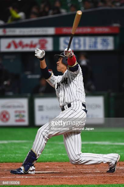 Infielder Hayato Sakamoto of Japan hits a pop fly in the bottom of the second inning during SAMURAI JAPAN Sendoff Friendly Match between Japan and...