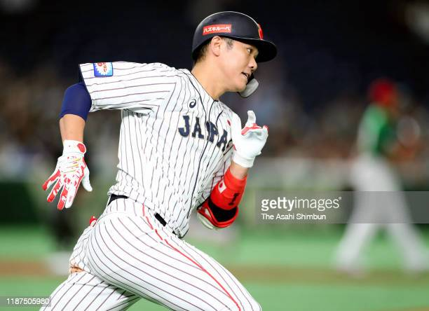 Infielder Hayato Sakamoto of Japan hits a RBI single in the bottom of 2nd inning during the WBSC Premier 12 Super Round game between Japan and Mexico...