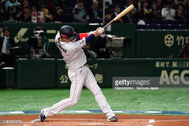 Infielder Hayato Sakamoto of Japan hits a single in the bottom of 1st inning during the WBSC Premier 12 Super Round game between Japan and Mexico at...