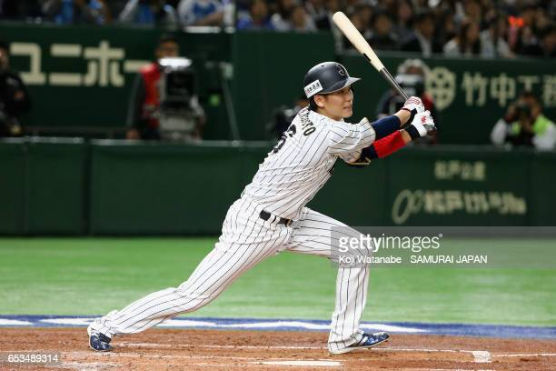 Infielder Hayato Sakamoto of Japan hits a single in the bottom of the second inning during the World Baseball Classic Pool E Game Six between Israel...