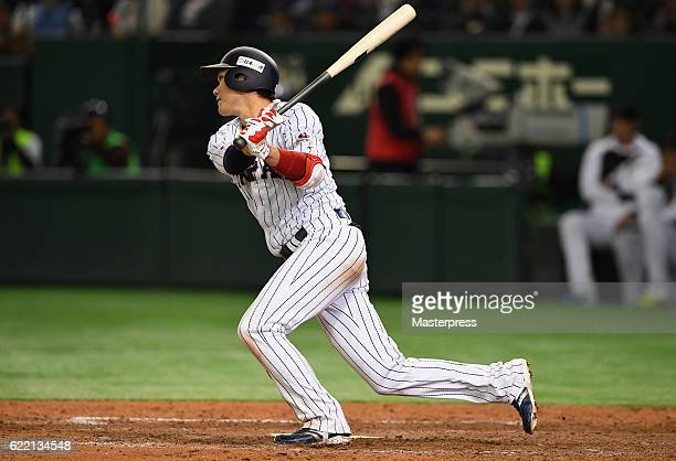 Infielder Hayato Sakamoto of Japan hits a single in the ninth inning during the international friendly match between Japan and Mexico at the Tokyo...