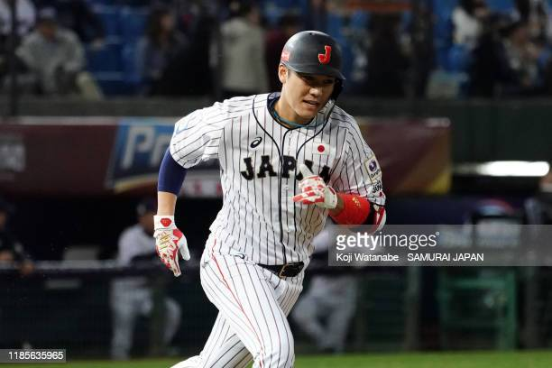 Infielder Hayato Sakamoto of Japan reacts after flying out in the bottom of 3rd inning during the WBSC Premier 12 Opening Round Group B game between...