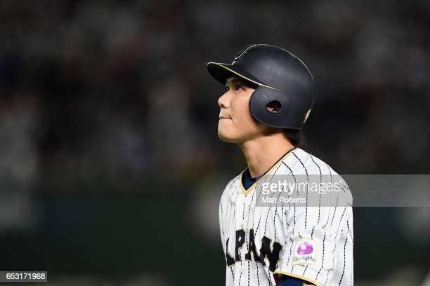 Infielder Hayato Sakamoto of Japan reacts after grounding out in the bottom of the first inning during the World Baseball Classic Pool E Game Four...