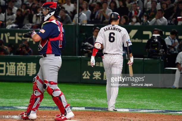 Infielder Hayato Sakamoto of Japan reacts after striking out in the bottom of 8th inning during the WBSC Premier 12 Super Round game between Japan...