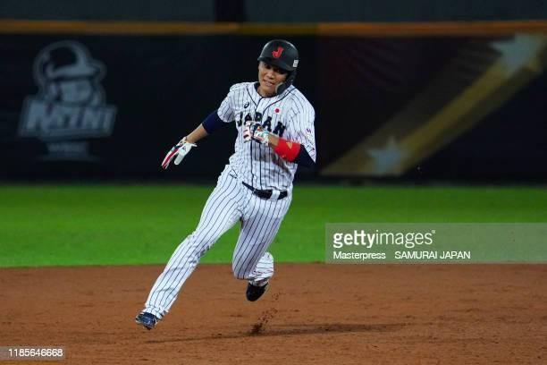 Infielder Hayato Sakamoto of Japan runs to the third base as Infielder Ryosuke Kikuchi hits a RBI double in the bottom of 5th inning during the WBSC...