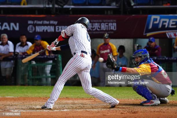 Infielder Hayato Sakamoto of Japan strikes out in the bottom of 6th inning during the WBSC Premier 12 Opening Round Group B game between Japan and...