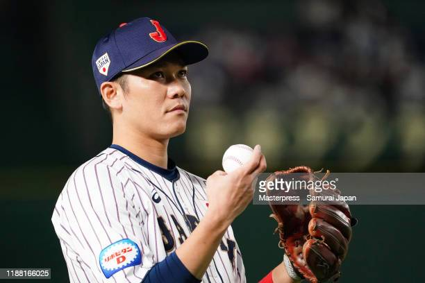 Infielder Hayato Sakamoto of Japan warms up prior to the WBSC Premier 12 final game between Japan and South Korea at the Tokyo Dome on November 17...