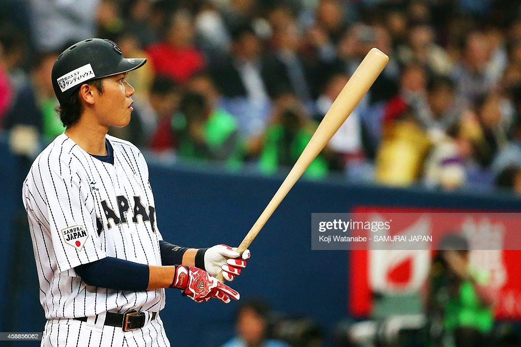 Infielder Hayato Sakamoto #6 of Samurai Japan in action during the game one of Samurai Japan and MLB All Stars at Kyocera Dome Osaka on November 12, 2014 in Osaka, Japan.
