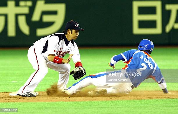 Infielder Hiroyuki Nakajima of Japan tags out Infielder Choi Jeong of South Korea in the top half of the ninth inning during the World Baseball...