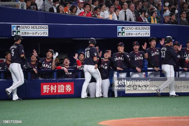 Infielder Hotaka Yamakawa, Catcher Tomoya Mori of Japan and Infielder Shuta Tonosaki of Japan celebrate scoring runs after Infielder Sosuke Genda...