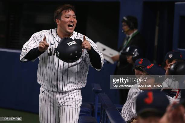Infielder Hotaka Yamakawa of Japan celebrates hitting a two-run double to make it 5-5 in the bottom of 7th inning during the game five between Japan...