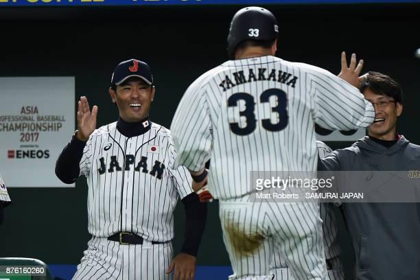 Infielder Hotaka Yamakawa of Japan celebrates with Head coach Atsunori Inaba after scoring a run to make it 10 by the RBI double of Infielder Shuta...