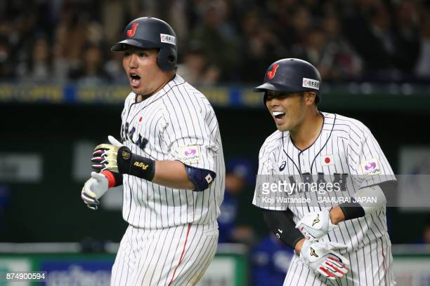 Infielder Hotaka Yamakawa of Japan celebrates with his team mate Catcher Kensuke Kondo after hitting a tworun in the bottom of sixth inning during...