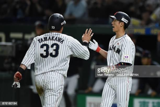 Infielder Hotaka Yamakawa of Japan celebrates with Infielder Ryoma Nishikawa after scoring a run to make it 10 by the RBI double of Infielder Shuta...