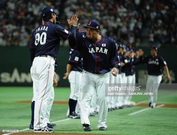 Infielder Hotaka Yamakawa of Japan high fives with Head coach Atsunori Inaba prior to the Eneos Asia Professional Baseball Championship 2017 game...
