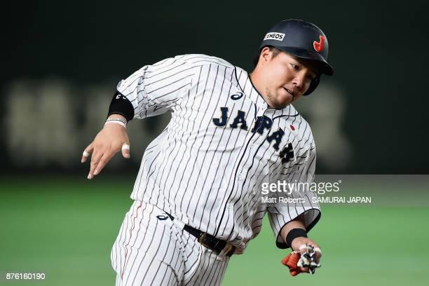 Infielder Hotaka Yamakawa of Japan runs to the home plate to score a run to make it 10 by the RBI double of Infielder Shuta Tonosaki of Japan in the...