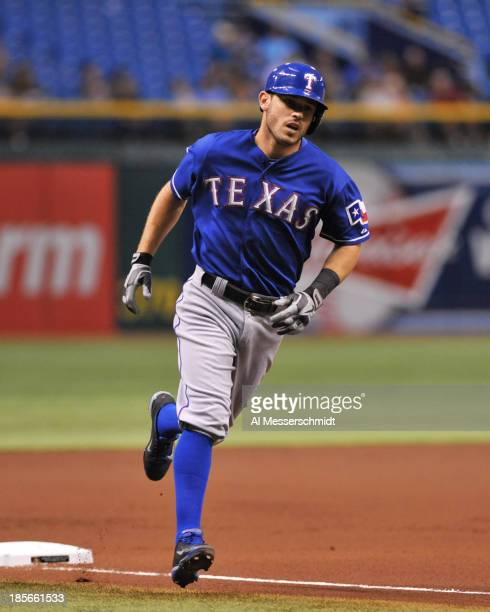 Infielder Ian Kinsler of the Texas Rangers homers in the 1st inning against the Tampa Bay Rays September 17 2013 at Tropicana Field in St Petersburg...