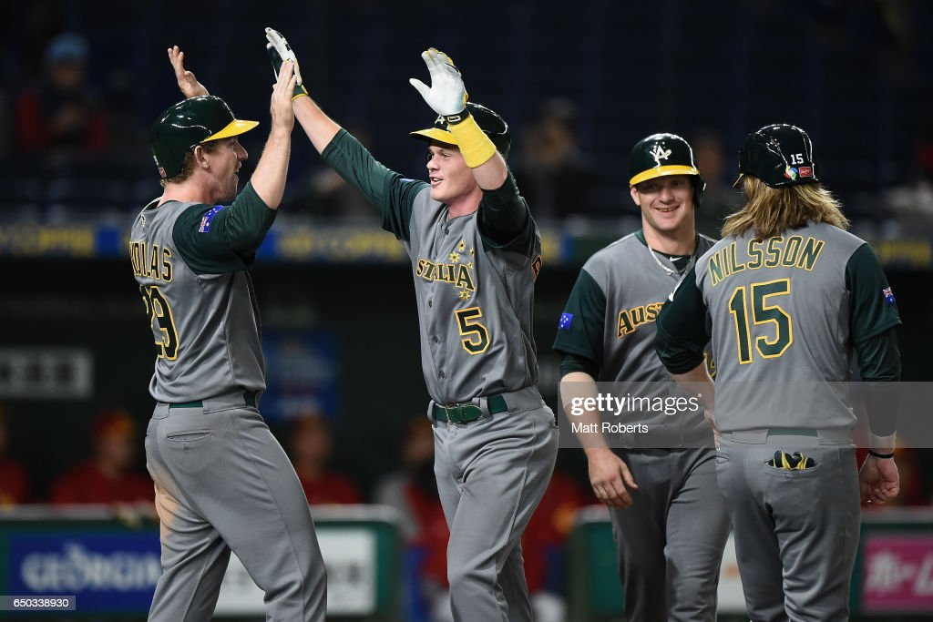 Infielder James Beresford (2nd L) #5 of Australia celebrates with his team mates Outfielder David Kandilas #29, Infielder Brad Harman #12 and Infielder Mitchell Nilsson #15 after hitting a grand slam to make it 11-0 in the top of the eighth inning during the World Baseball Classic Pool B Game Four between Australia and China at the Tokyo Dome on March 9, 2017 in Tokyo, Japan.