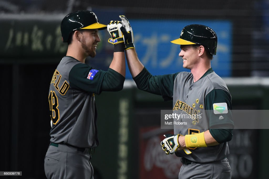 Infielder James Beresford (R) #5 of Australia celebrates with his team mate Outfielder Aaron Whitefield #48 after hitting a grand slam to make it 11-0 in the top of the eighth inning during the World Baseball Classic Pool B Game Four between Australia and China at the Tokyo Dome on March 9, 2017 in Tokyo, Japan.