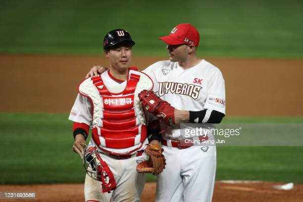 Infielder Jamie Romak and catcher Lee HongKu of SK Wyverns celebrate after winning the KBO League game between Hanwha Eagles and SK Wyverns at the...