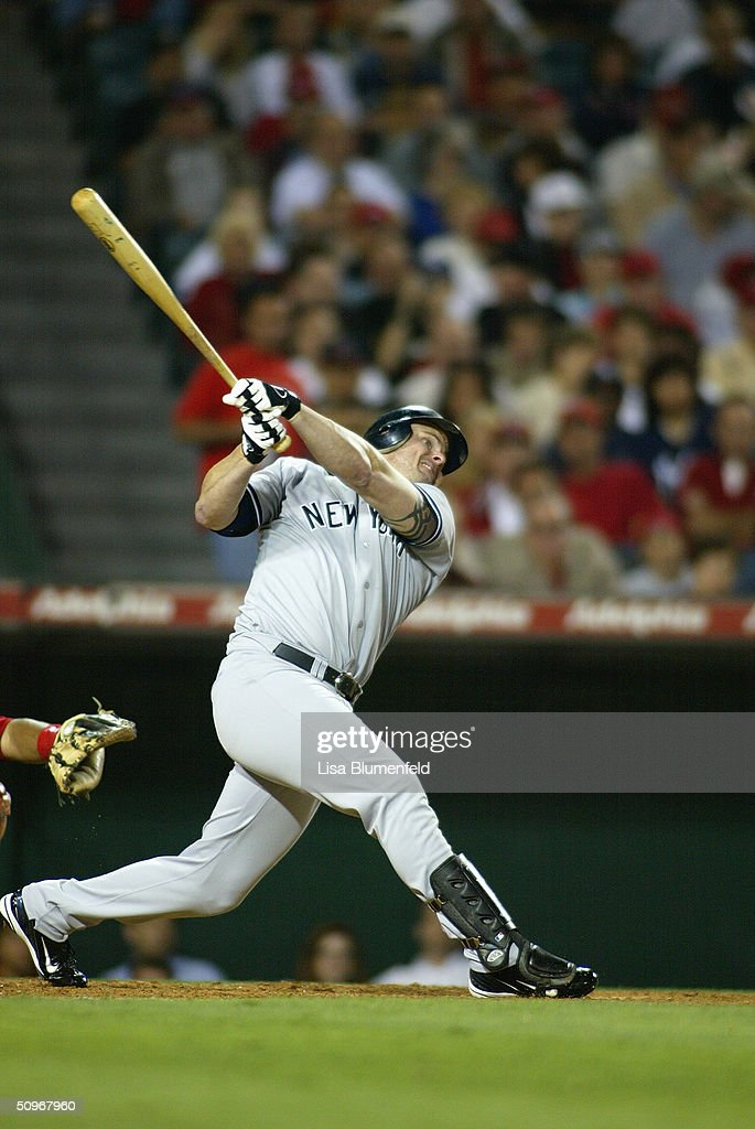 Infielder Jason Giambi #25 of the New York Yankees swings at an Anaheim Angels pitch during the game at Angel Stadium on May 19, 2004 in Anaheim, California. The Yankees won 4-2.