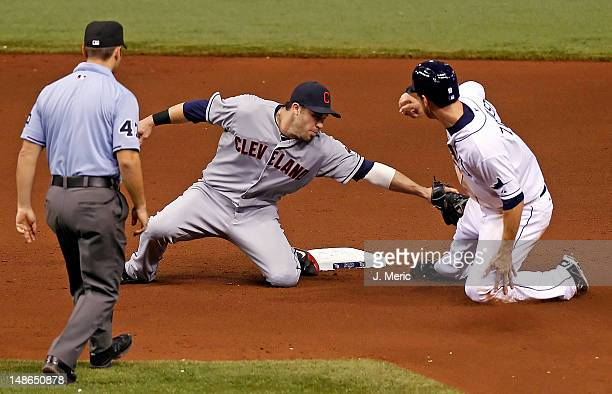 Infielder Jason Kipnis of the Cleveland Indians applies the tag to Ben Zobrist of the Tampa Bay Rays as he was out on this steal attempt during the...
