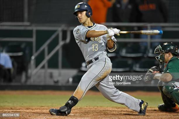 FIU infielder JavierValdes bats as the FIU Golden Panthers defeated the University of Miami Hurricanes 121 on March 7 at Alex Rodriguez Park at Mark...