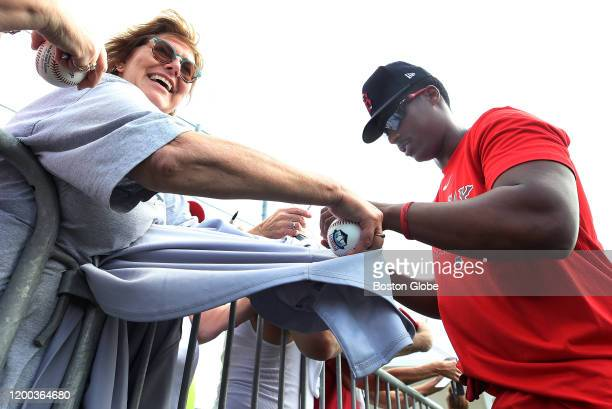 Infielder Jeter Downs recently acquired from the Dodgers in the Mookie Betts trade signs some autographs for fans during the first official workout...