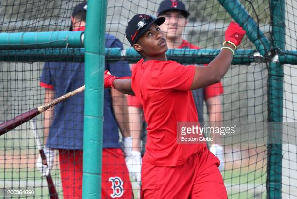Infielder Jeter Downs recently acquired from the Dodgers in the Mookie Betts trade practices at the bat during the first official workout of Boston...
