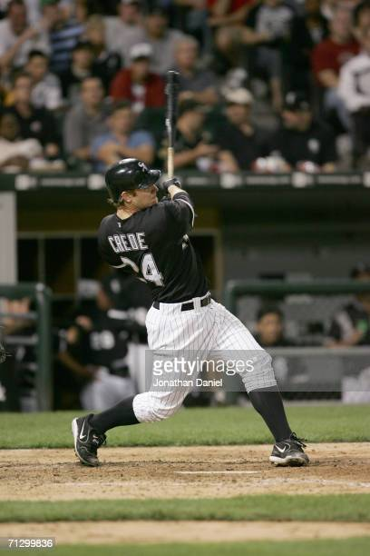 Infielder Joe Crede of the Chicago White Sox swings at a St Louis Cardinals pitch on June 20 2006 at US Cellular Field in Chicago Illinois The White...