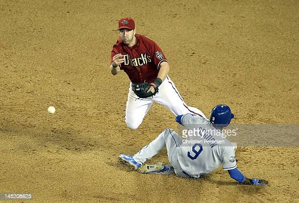 Infielder John McDonald of the Arizona Diamondbacks throws over the sliding Dee Gordon of the Los Angeles Dodgers to complete a game ending double...