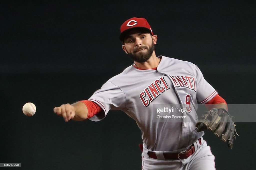 Infielder Jose Peraza #9 of the Cincinnati Reds fields a ground ball out against the Arizona Diamondbacks during the MLB game at Chase Field on July 9, 2017 in Phoenix, Arizona. The Reds defeated the Diamondbacks 2-1.